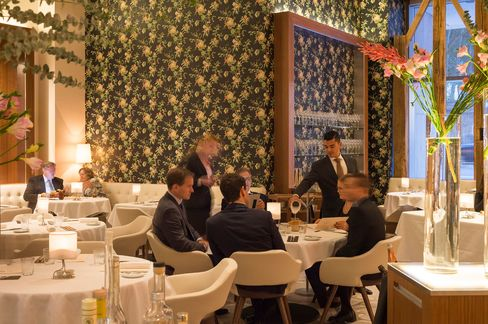The dining room is comfortable, with plush seats and cream banquettes.