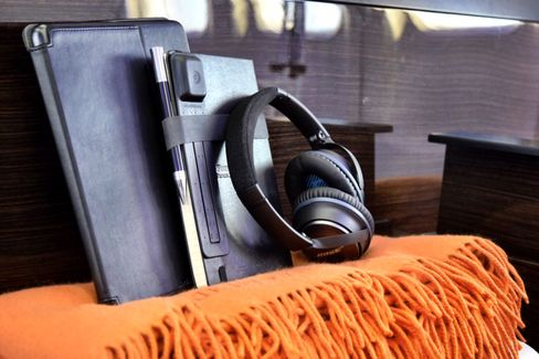 Guests receive their own personal Bose headphones, leather travel journal, iPad Air, and Mongolian cashmere blanket.