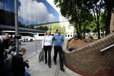 Tom Hayes and his wife Sarah arrive for trial at Southwark Crown Court in London on July 29.
