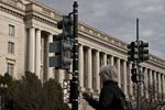 A pedestrian walks past the IRSheadquarters in Washington, D.C.