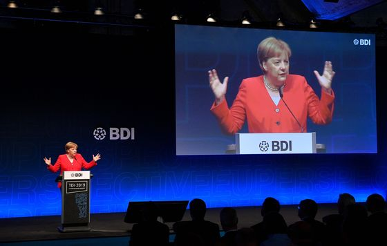 Merkel Says EU Antitrust Rules Are Naive About Threat of China