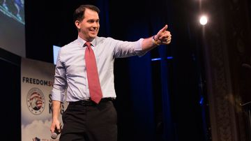 Scott Walker, governor of Wisconsin, gestures to the crowd during the Iowa Freedom Summit in Des Moines, Iowa, U.S., on Saturday, Jan. 24, 2015.