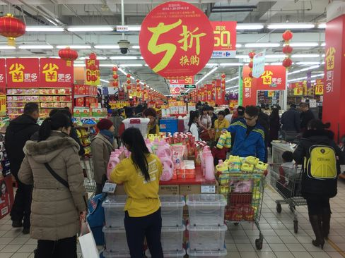 Shoppers look for bargains at a Carrefour holiday sale in Harbin, China.