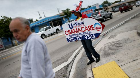 A sign directing people to an Insurance company where they can sign up for the Affordable Care Act, also known as Obamacare, before the February 15th deadline in Miami.