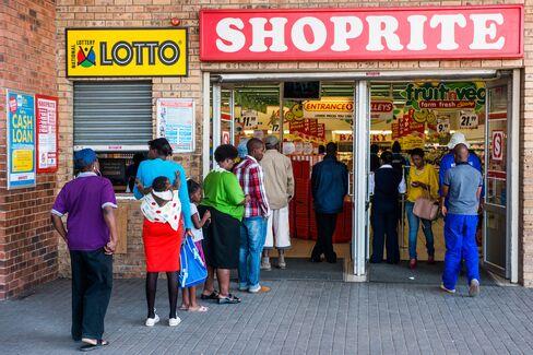 Customers queue to enter Shoprite