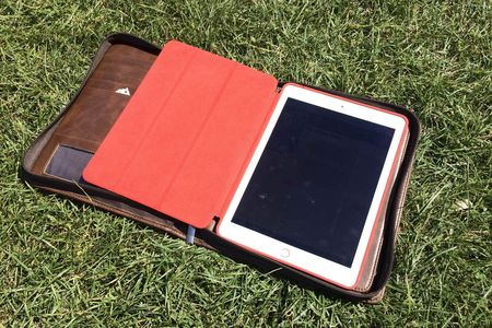 A leather folder contained our trusty tablet guide, a notebook, and room to store a clue or two.