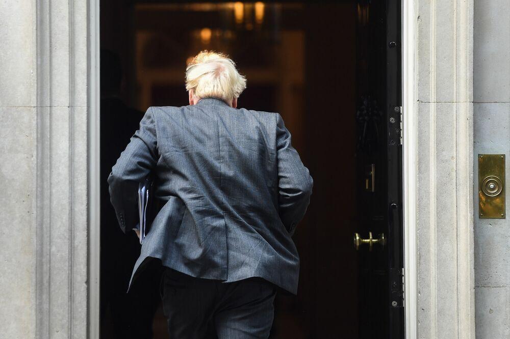 U K Lockdown Boris Johnson S Six Month Covid Plan Carries Heavy Cost Bloomberg