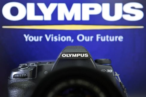 Olympus Panel to Disclose Probe Into Acquisitions