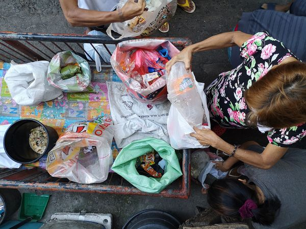 People collect segregated wastes from households in Potrero, Malabon City. Image: Global Alliance for Incinerator Alternatives