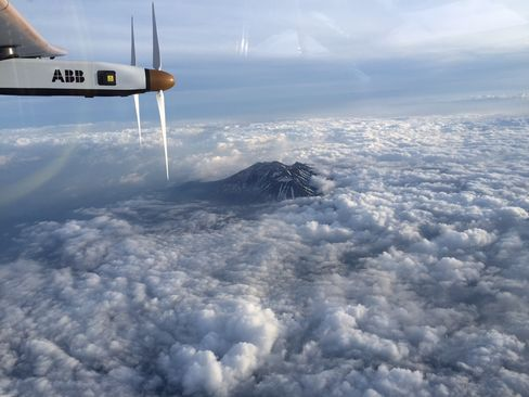 Catching solar rays above the clouds near the Nagano mountain region in Japan.