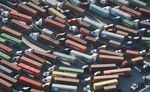 Trucks stand prepared to haul shipping containers at the Port of Los Angeles.