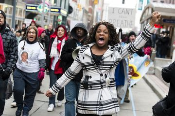 CLEVELAND, OH - DECEMBER 21: An unidentified young woman marches on Euclid Ave. December 21, 2014, in Cleveland, Ohio. Protestors gathered in downtown Cleveland for the second day in a row to voice opposition to excessive use of police force. (Photo by Angelo Merendino/Getty Images)