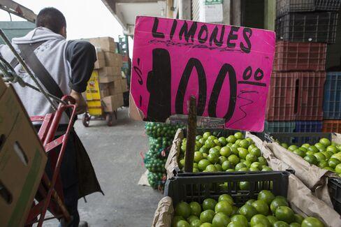 A Laborer Hauls Goods at a Market