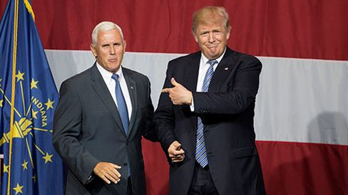Presumptive Republican presidential nominee Donald Trump and Indiana Governor Mike Pence take the stage during a campaign rally in Westfield, Indiana, on July 12, 2016.