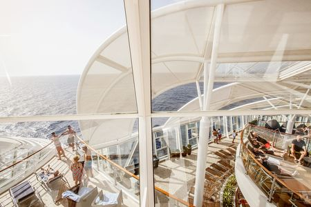 The three-story, adults-only Solarium enclave sits toward the bow of the ship, with four cantilevered whirlpools suspended 136 feet above the ocean.