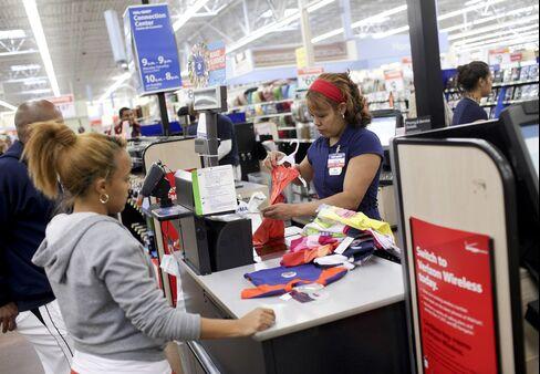 A customer checks out at Wal-Mart