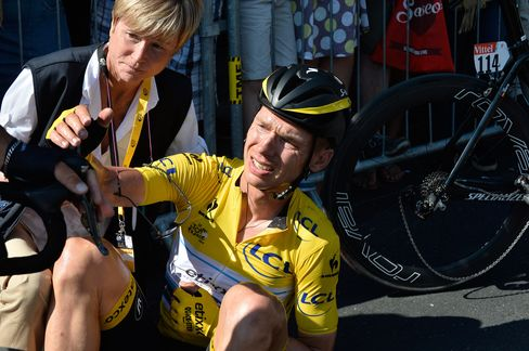 Germany's Tony Martin, wearing the overall leader's yellow jersey, lies on the road with a broken collar bone after crashing in the last kilometers of the sixth stage of the Tour de France cycling race over 191.5 kilometers (119 miles) with start in Abbeville and finish in Le Havre, France, Thursday, July 9, 2015.