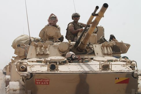 Pro-government tanks in the Saudi-led coalition, deployed on the outskirts of the southern Yemeni port city of Aden on August 3, 2015.