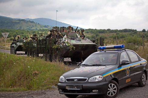 Ukrainian Government forces patrol near Mukacheve, Ukraine, Monday, on July 13, 2015.