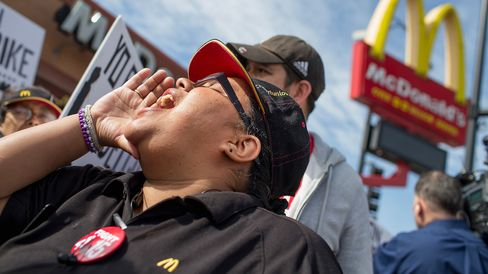 Demonstrators gather in front of a McDonald's restaurant to call for an increase in minimum wage on April 15, 2015 in Chicago.