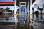 Floodwaters from Hurricane Harvey surround a fuel pump at an Exxon Mobil Corp. gas station in Houston, Texas, U.S.