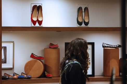 A Customer Browses Shoes for Sale