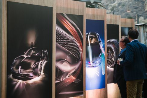 Guests peruse artistic mock-ups of theKarma Revero during the Laguna Beach unveiling.