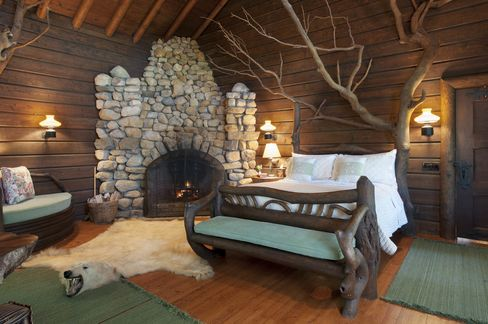 """The """"tree house"""" bedroom features a bed made from a tree."""