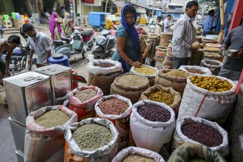 A customer browses pulses at a local market in Hyderabad.