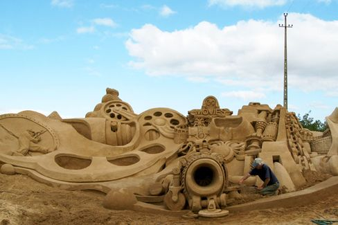 The Former Project Manager Turned Sand Castle Builder