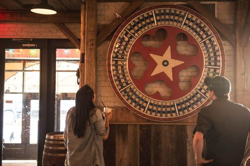 On the way out of El Original, you'll notice a giant wheel in the lobby of the restaurant, covered with images of dominoes.