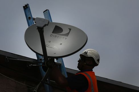 A DirecTV Technician Installs a New Satellite TV Dish