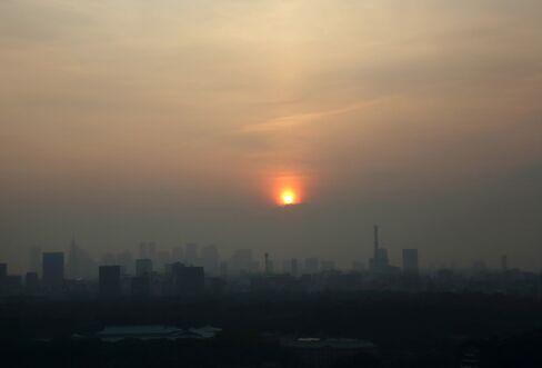 The Sun Sets behind Buildings in Tokyo