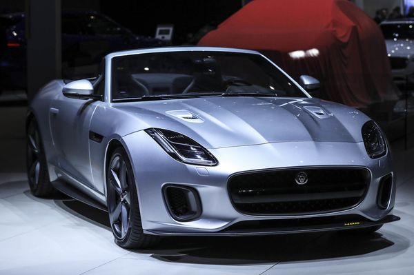 A Jaguar F-type 400 sport luxury automobile, produced by Tata Motors Ltd.'s Jaguar Land Rover unit, stands on display on the first day of the 87th Geneva International Motor Show in Geneva, Switzerland, on Tuesday, March 7, 2017. The show opens to the public on March 9, and will showcase the latest models from the world's top automakers. Photographer: Chris Ratcliffe/Bloomberg