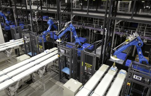 Industrial robots sort items at a distribution center in Kuki, Japan
