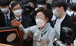 Former South Korean 'comfort woman' Lee Yong-soo speaks to the media after a court ruling in Seoul on April 21.