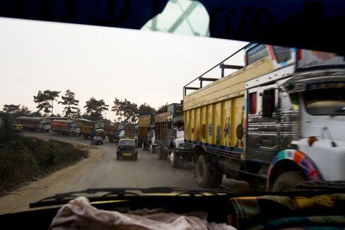 Trucks Carrying Coal Sit In Traffic