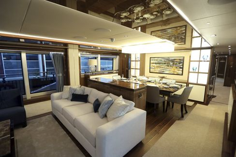 A dressed dining table sits in the dining area onboard a Sunseeker 131 yacht during the 2016 London Boat Show.