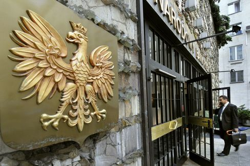 The White Eagle, the national emblem of Poland, hangs at the entrance to the central bank of Poland in Warsaw, Poland.