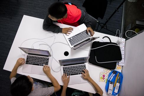 Students work on their laptop during a computer coding class in Hong Kong.