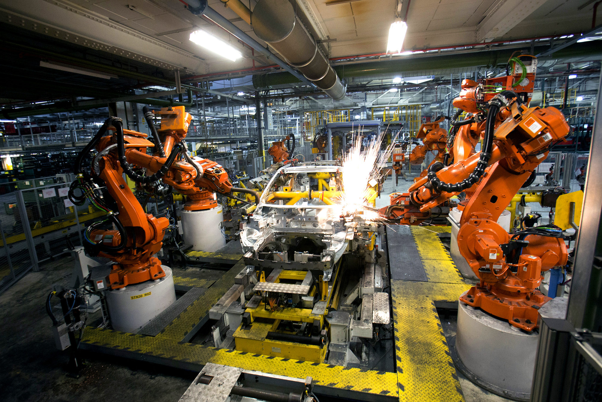 Race to make robots for china spurs abb to double capacity bloomberg malvernweather Choice Image
