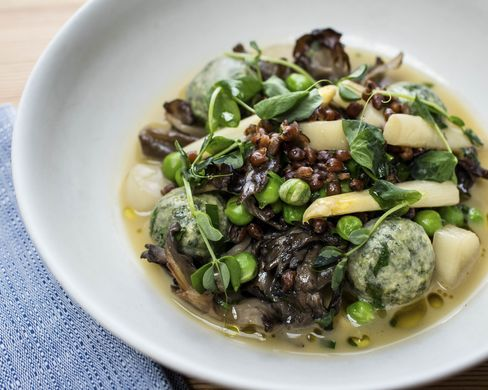 The food is vegetarian (and in many cases vegan, as well) but it appeals to a wide range of eaters with big, bold flavors, as in this dish of smoky mushrooms with tender green dumplings.