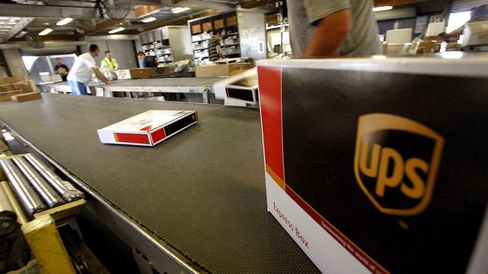 United Parcel Service Inc. packages travel down a conveyor belt in the sort area at the UPS air hub at Mather Airport in Sacramento, California, U.S., on Monday, July. 25, 2011.