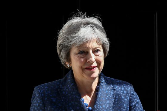 Brexit Bulletin: May's Slow, Long Game