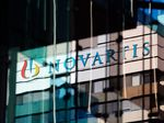 A logo sits on display on a building at the Novartis AG campus.