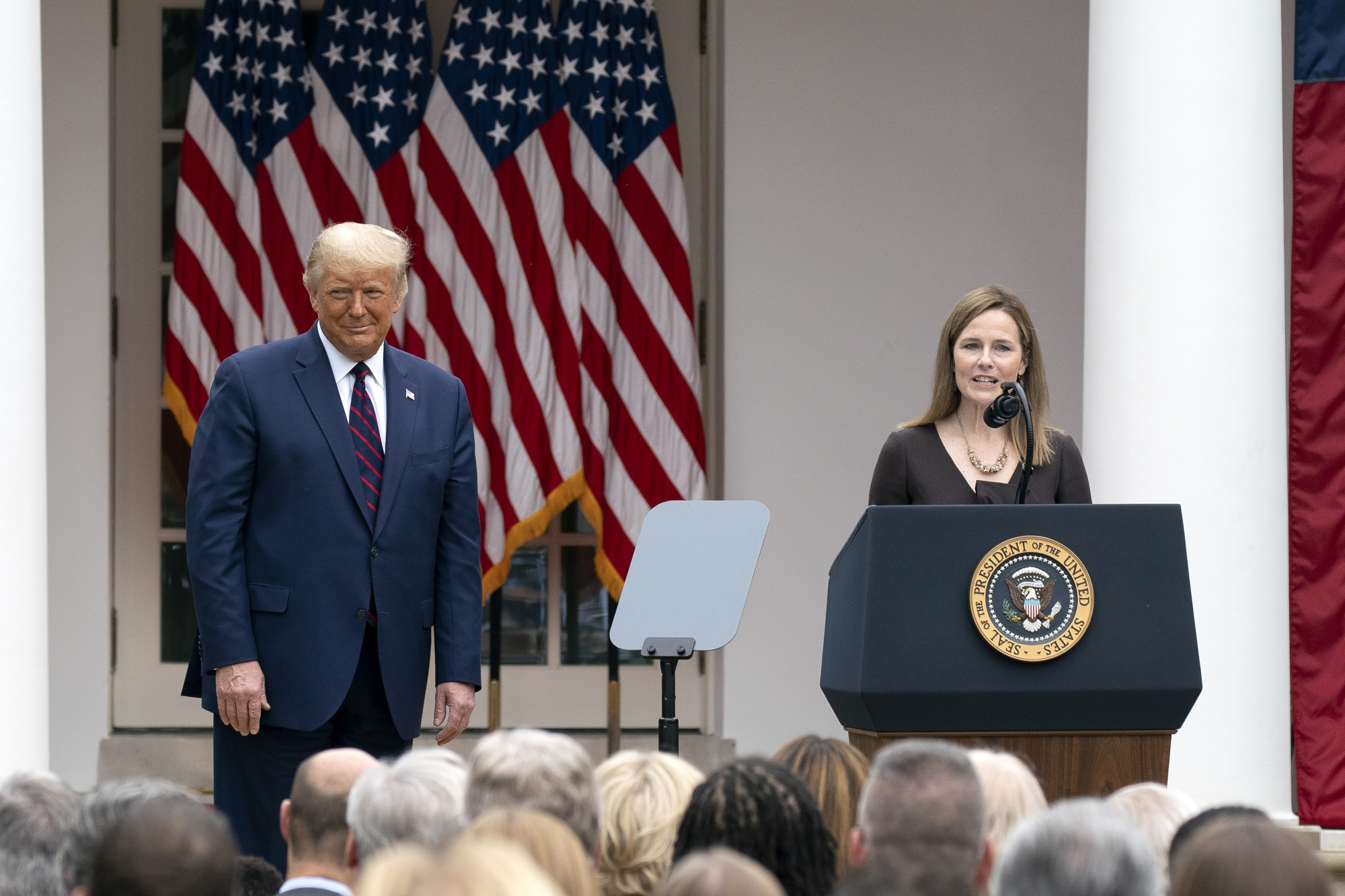 Amy Coney Barrett speaks as President Donald Trump listens during an announcement ceremony at the White House in Washington, D.C., on Saturday, Sept. 26.