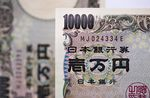 Japanese 10,000 yen banknotes are arranged for a photograph in Tokyo, Japan, on Thursday, Sept. 7, 2017. Japanese stocks fell as the yen strengthened while investors prepared themselves for the economic damage that Hurricane Irma may inflict on Florida and mulled U.S. President Donald Trump's most recent comments on North Korea.