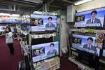 Televisions being sold at an Onoden Co. electronics store display an image of North Korean leader Kim Jong Un during a news report on North Korea's missile launch in Tokyo, Japan.