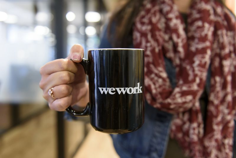 Swire properties signs deal with wework for hong kong space bloomberg photographer mike shortbloomberg malvernweather Images