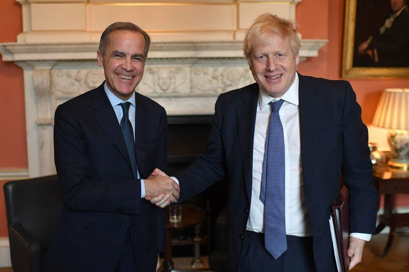 Mark Carney, left, is an adviser to U.K. Prime Minister Boris Johnson for the COP26 climate summit due to take place in November in Glasgow, Scotland